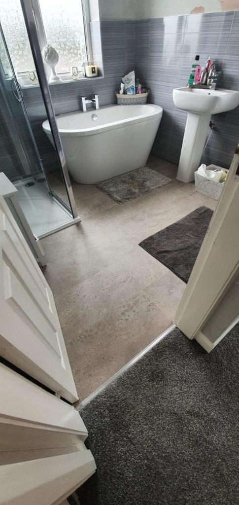 EGGER PRO Aqua Plus Grey Karnak Granite Kingsize 8mm Laminate Flooring | The Carpet Shop Southport