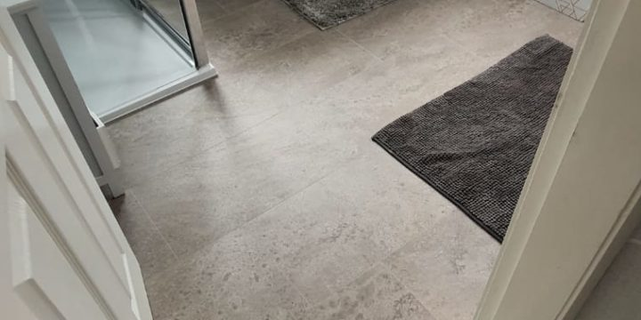EGGER PRO Aqua Plus Grey Karnak Granite Kingsize 8mm Laminate Flooring | The Carpet Shop Southport